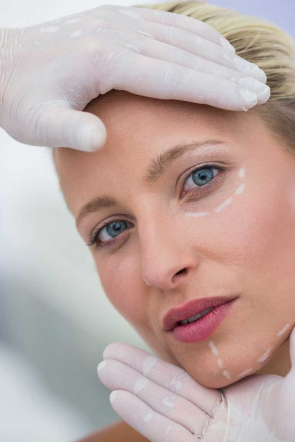 doctor-examining-female-patients-face-for-cosmetic-treatment (1)