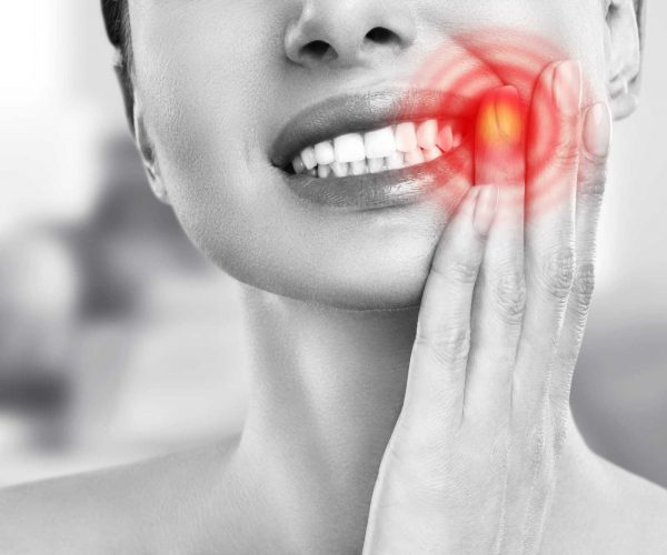 tooth-pain-dentistry-young-woman-suffering-from-strong-teeth-pain-touching-cheek-with-hand-female-feeling-painful-toothache-dentistry-care-concept (1)